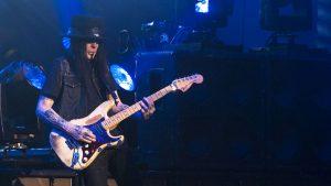 Mick Mars playing guitar