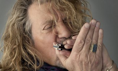 Robert Plant playing harmonica