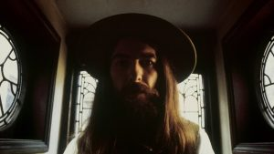 George Harrison with a hat