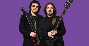 Geezer Butler and Tony Iommi purple background