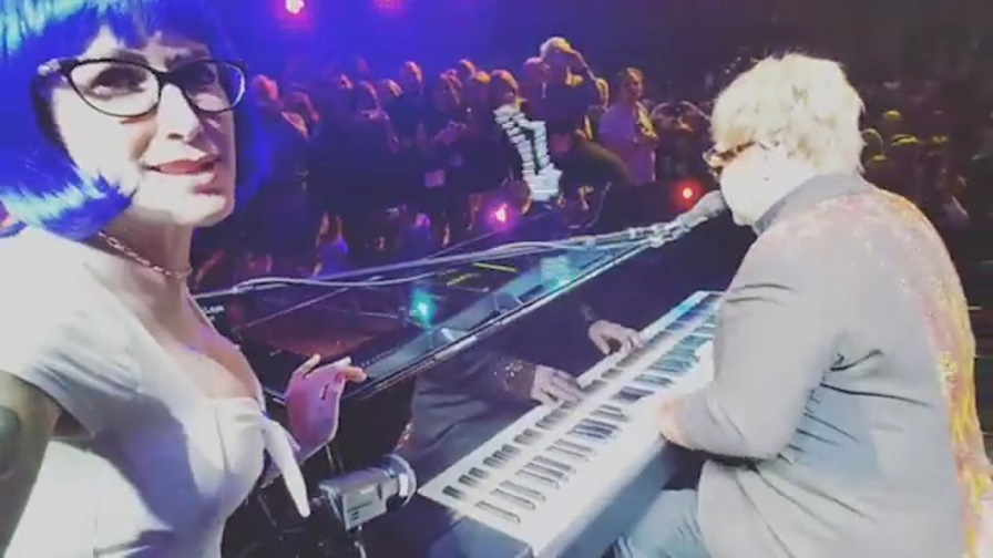 Watch Elton John being hit by a necklace during a show