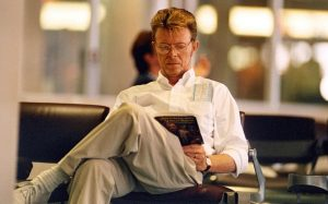 David Bowie reading a book