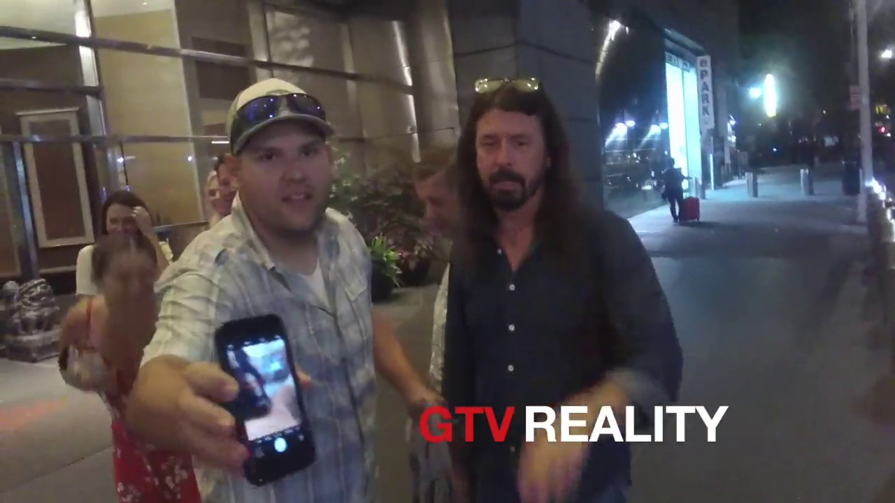 Dave Grohl signs autographs to fans