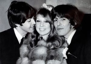 Paul McCartney and George Harrison with a girl