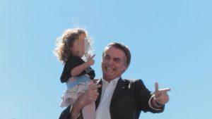 Jair Bolsonaro and little girl gun hand