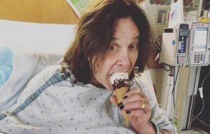 Ozzy Osbourne taking ice cream in the hospital