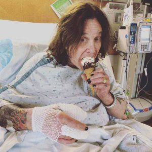 Ozzy Osbourne taking ice cream in the hospital