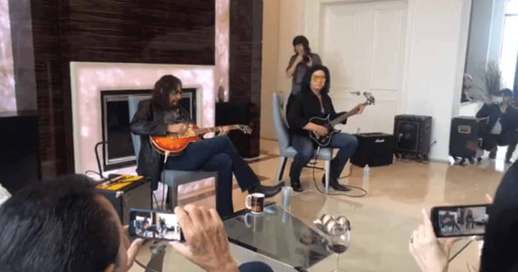 Ace Frehley and Gene Simmons play at fans home