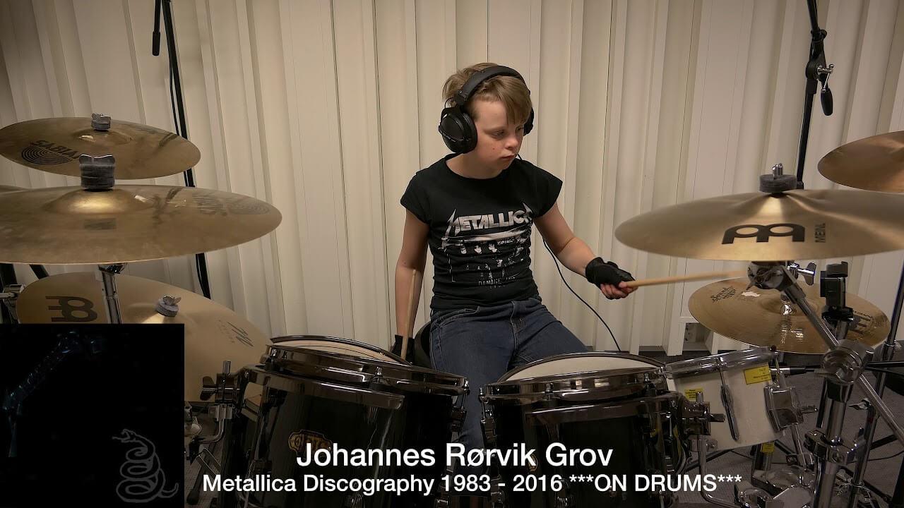 Kid playing Metallica on drums