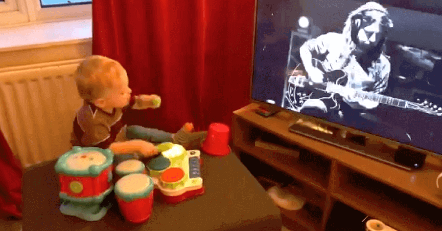 Kid plays the drums while sees Dave Grohl